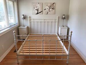 Queen bed, nightstands, and wall art