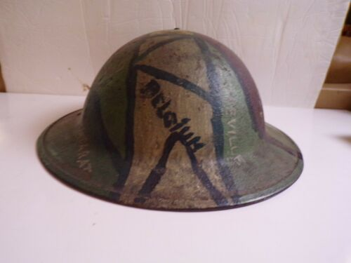 WW1 DOUGHBOY HELMET. EXTENSIVE PERIOD APPLIED PAINT. THE SOLDIERS TOUR OF DUTY?