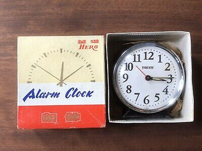 vintage wind up alarm clock Black/white colour metal in working order