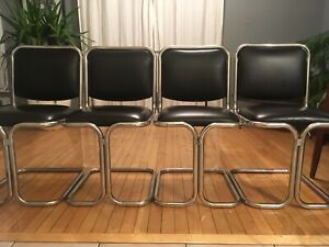 Vintage mid century modern Stainless Steel cantilever chairs