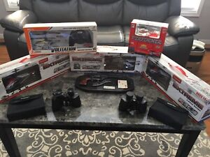RC helicopter lot,  2 Bushnell binoculars, carved wood gun.