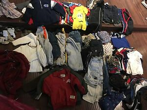 Piles of boys size 3 and 4 clothing