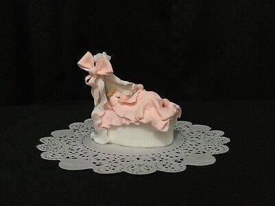 - Cold Porcelain Baby Girl in Bassinet Cake Topper, Baby Shower, Party Favor