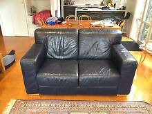Pair of Natuzzi leather sofas, dark blue Middle Park Port Phillip Preview