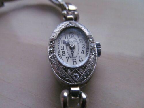 Ladies Vintage Platinum watch with diamonds