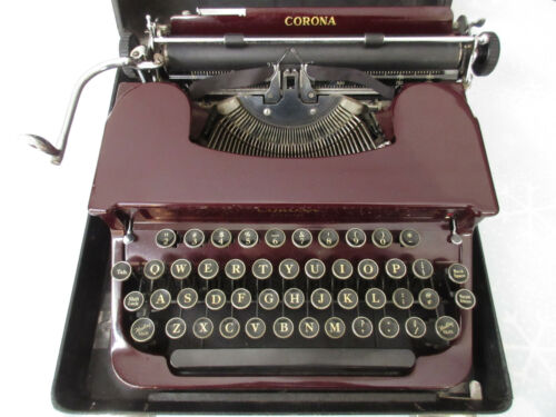 Vintage 1938 Smith Corona Sterling typewriter burgundy/red with case