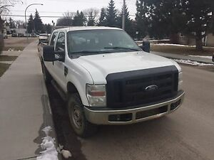 2010 F-350 1 ton 4x4 crew cab 4 door long box low Km's