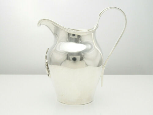 ANTIQUE SILVER CRESTED CREAM JUG WORSHIPFUL COMPANY OF CUTLERS HM B