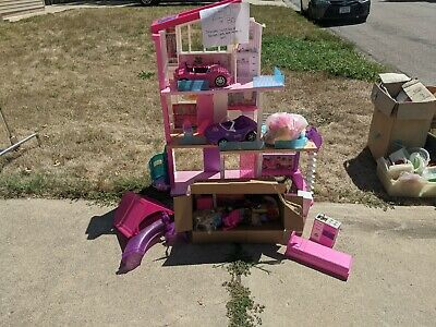 barbie dream house with elevator and pool/lot of Barbies and accessories