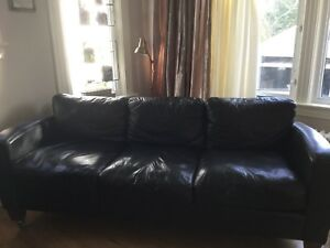 Large black leather sofa