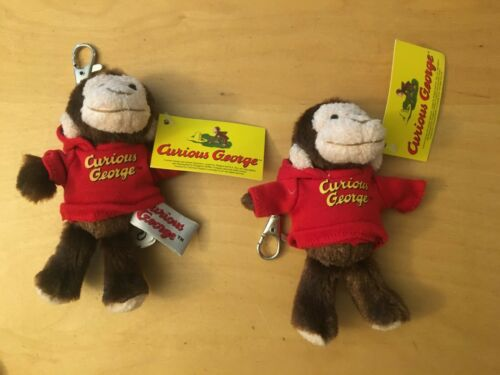 (2) TWO CURIOUS GEORGE BRAND NEW KEY CHAINS WITH TAGS