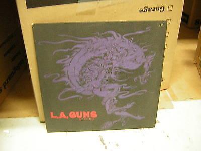 LA GUNS LP PROMO 12 INCH ....<br>
