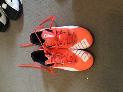 Boys orange puma football boots AstroTurf size 5
