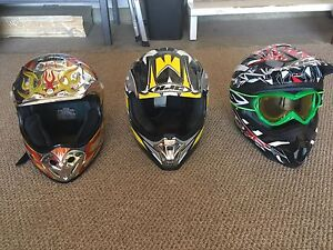 Motocross helmets and green goggles
