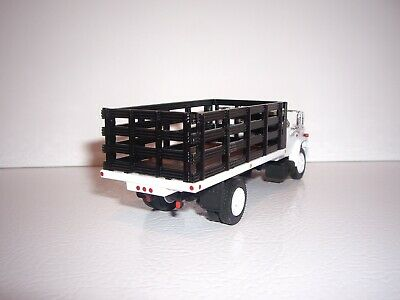 DCP FIRST GEAR 1/64 WHITE CAB BLACK STAKE SIDE GMC 6500 SINGLE AXLE STAKE TRUCK  2