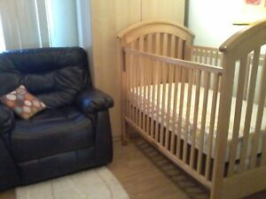 Crib, mattress, bumper pads and two crib sheets