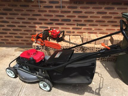 Honda self propelled mower chainsaw and hedger package bargain
