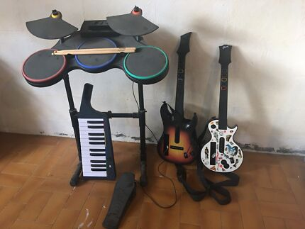 Wii Guitar Hero and Rockband Instruments