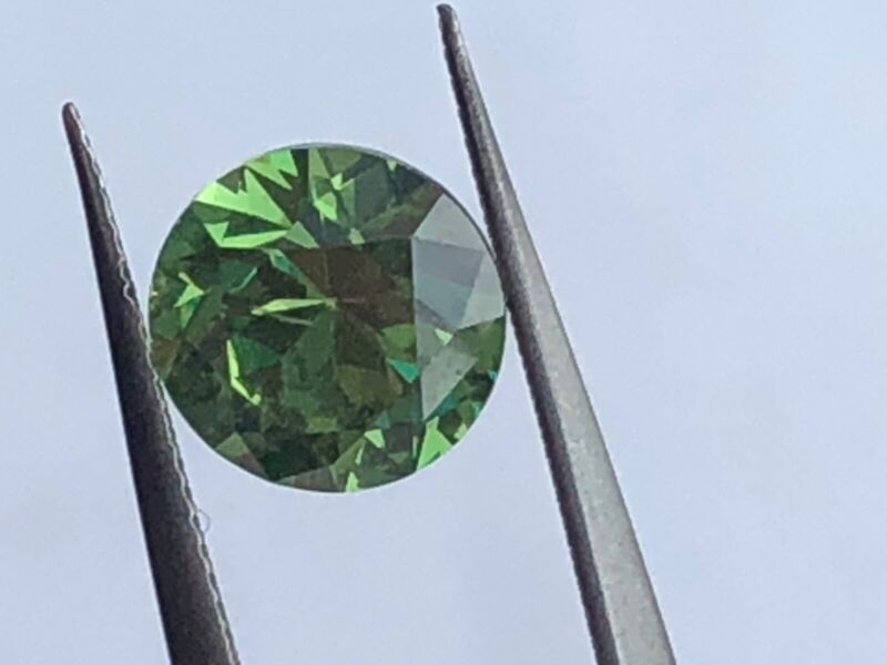 One loose stone demantoid garnet with GIA lab Report