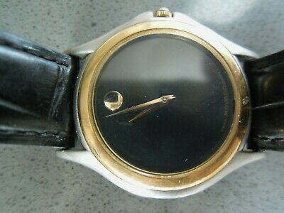 Movado Museum mens' black face watch with gold trim and black leather band
