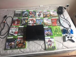 Xbox 360 W/About 20 games and 2 controllers.
