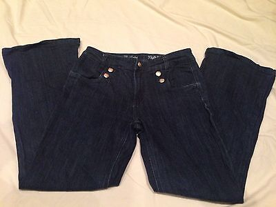 The Limited High waist Flare Leg Dark Wash Womens Jeans Size 6 has gold buttons