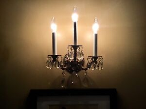 Brass and crystal wall sconces
