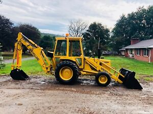 NEW HOLLAND 555B TLB BACKHOE LOADER FULL CAB RUBBER TIRE TRACTOR 4-1 BUCKET