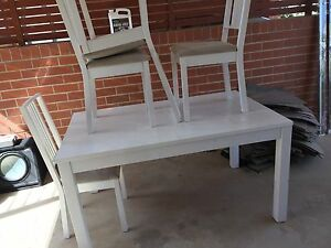 White extendable dining table and chairs Minto Campbelltown Area Preview