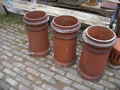 Reclaimed red flanged shoulder chimney pots.