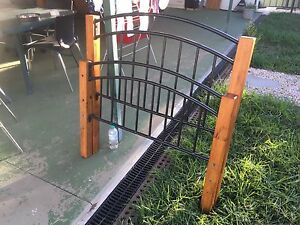 Brown wood and steel single bed frame St Marys Penrith Area Preview