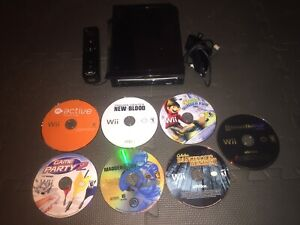 Black Nintendo Wii and Games