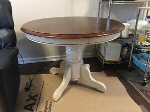 Pedestal dining room table. Like new. With leaf and 4 chairs
