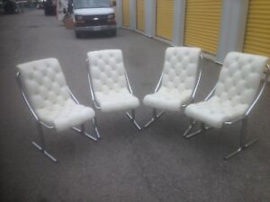 4 mid-century modern vinyl and chrome chairs