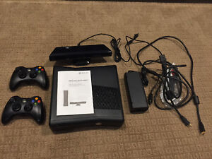XBox 360 w/Kinect, Two Controllers, Quick Charge and Games