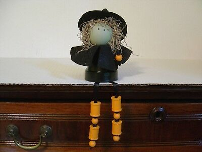 HAND CRAFTED HALLOWEEN DECORATION SITTING BLACK WITCH WITH HANGING LEGS - Halloween Witch Hand Craft