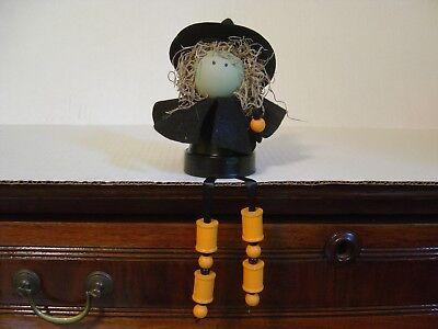 HAND CRAFTED HALLOWEEN DECORATION SITTING BLACK WITCH WITH HANGING - Halloween Witch Hand Craft