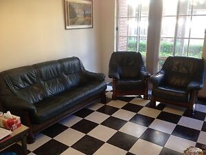 Dark green leather lounge Caringbah Sutherland Area Preview