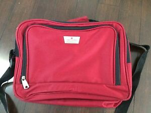 Red personal size carry on duffle