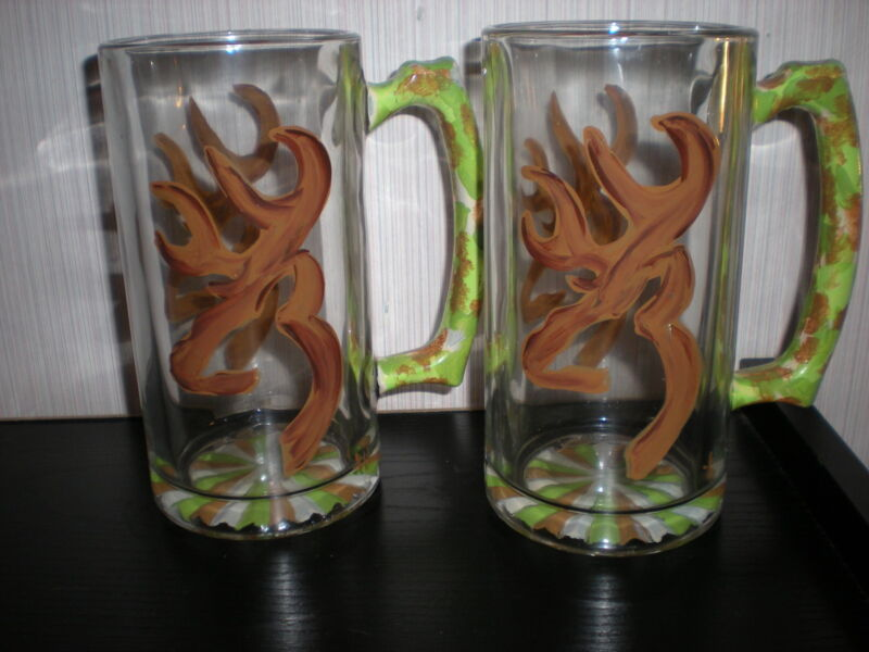 HAND PAINTED CAMO DEER HEAD IN BROWNS AND GREENS. . SET OF 2 BEER MUGS