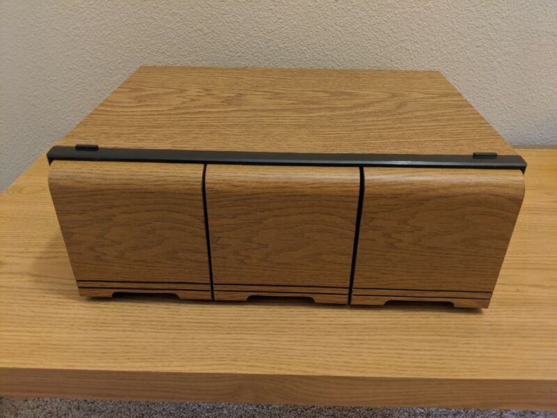 60 CD Storage Cabinet. Faux wood grain, each drawer holds 20 CDs, vintage