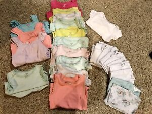 A brunch of size 24months/2 undershirts onsies
