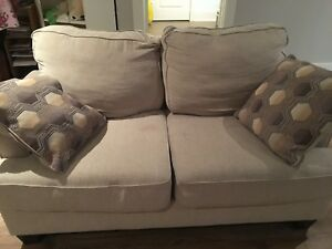 2 Mildly used Loveseat for sale @ 650CAD for both
