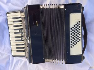 OLD accordion squeezebox. What is it worth??