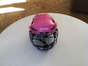 Small CCM pink hockey helmet.