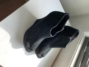 Black assorted heels and boots
