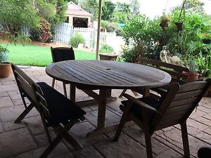 Outdoor wooden table 5 piece set w cushions (needs a sand & oiling) Keperra Brisbane North West Preview