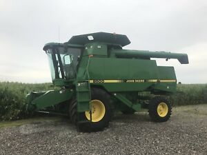 1996 John Deere 9500 and corn head