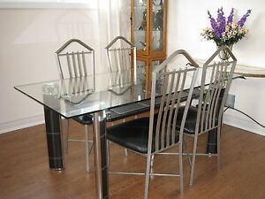 Glass top dining table with 4 matching leather chairs