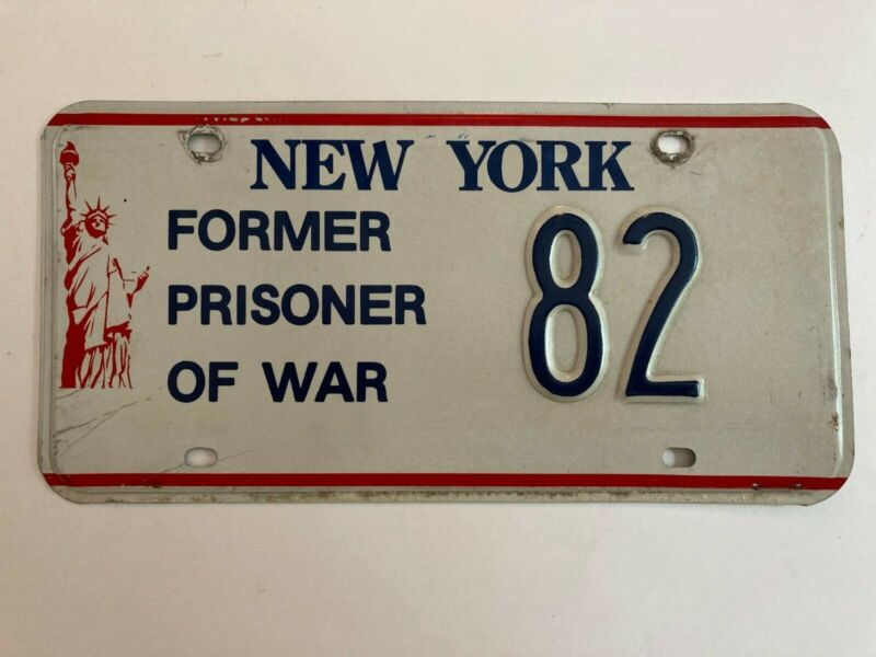 1986 New York POW Prisoner of War License Plate Low Number 2 Digit Liberty Base